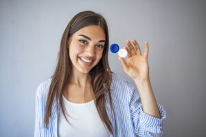 Young female holding contact lens case