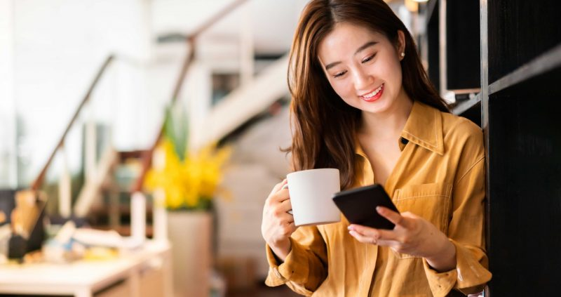 Female looking at cell phone smiling